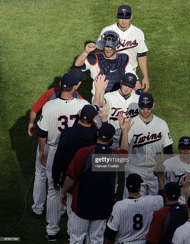 The Minnesota Twins celebrate a win of the game against the Texas Rangers on April 27, 2013 at Target Field in Minneapolis, Minnesota. The Twins defeated the Rangers 7-2.