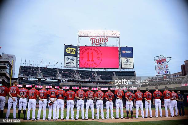 The Minnesota Twins line up to pay respects to Jacob Wetterling before the game against the Cleveland Indians on September 9 2016 at Target Field in...