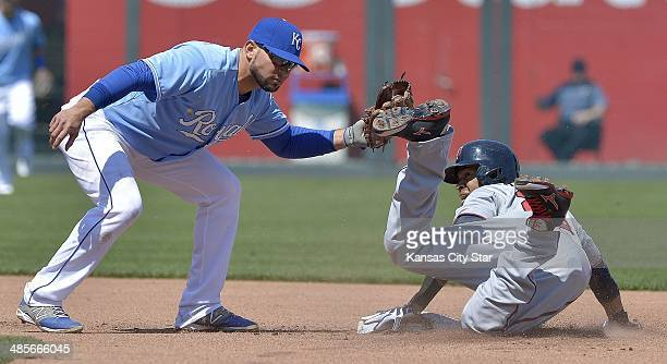 The Minnesota Twins' Pedro Florimon steels second base ahead of the tag from Kansas City Royals second baseman Omar Infante at Kauffman Stadium in...