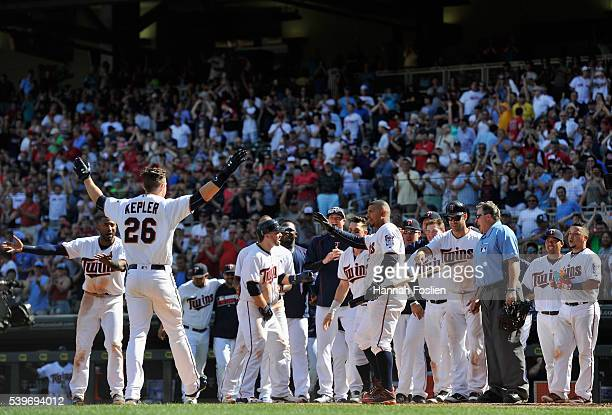 The Minnesota Twins wait to congratulate Max Kepler on a walkoff threerun home run against the Boston Red Sox in the tenth inning of the game on June...