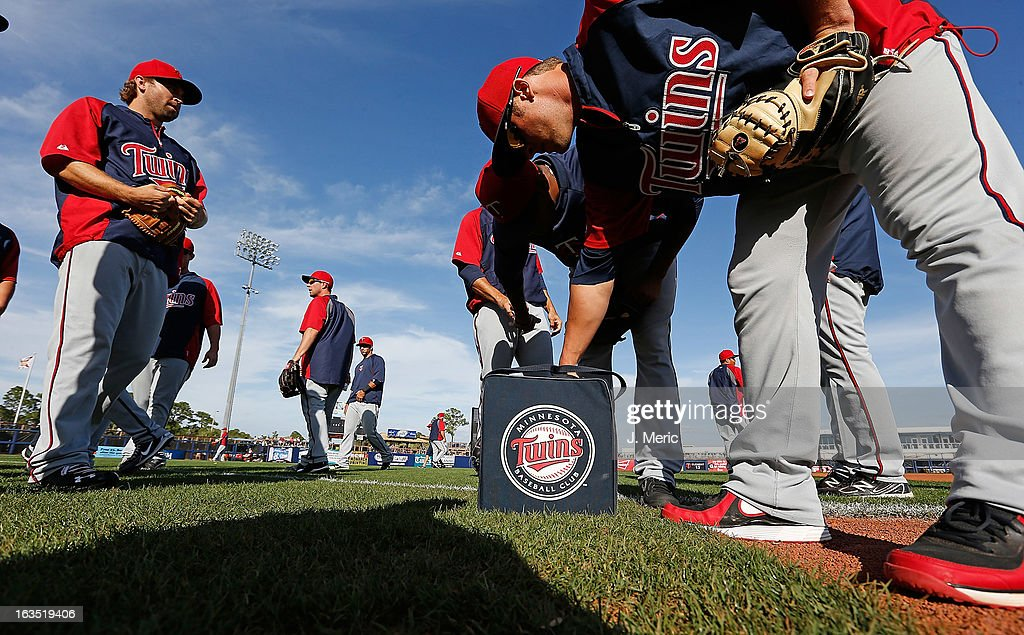 The Minnesota Twins warm up before the start of a Grapefruit League spring training game against the Tampa Bay Rays at the Charlotte Sports Complex on March 11, 2013 in Port Charlotte, Florida.