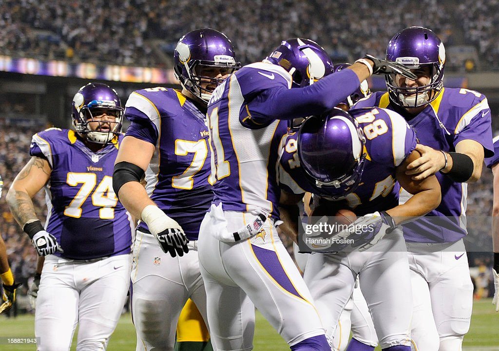 The Minnesota Vikings celebrate a touchdown by <a gi-track='captionPersonalityLinkClicked' href=/galleries/search?phrase=Michael+Jenkins&family=editorial&specificpeople=240136 ng-click='$event.stopPropagation()'>Michael Jenkins</a> #84 during the fourth quarter of the game against the Green Bay Packers on December 30, 2012 at Mall of America Field at the Hubert H. Humphrey Metrodome in Minneapolis, Minnesota. The Vikings defeated the Packers 37-34.