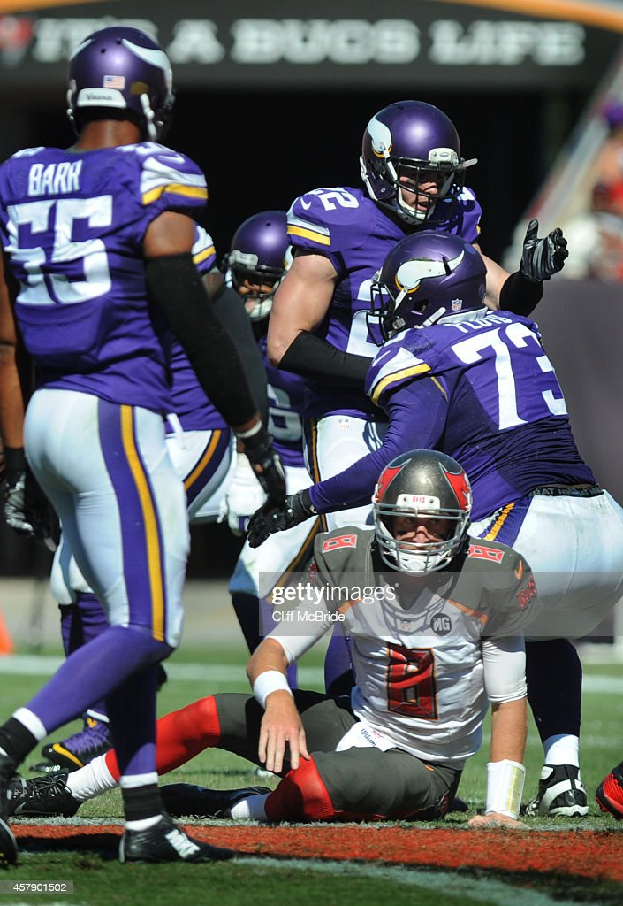 The Minnesota Vikings defense celebate a sack of quarterback <a gi-track='captionPersonalityLinkClicked' href=/galleries/search?phrase=Mike+Glennon+-+American+football-speler&family=editorial&specificpeople=11404080 ng-click='$event.stopPropagation()'>Mike Glennon</a> #8 of the Tampa Bay Buccaneers in the third quarter at Raymond James Stadium on October 26, 2014 in Tampa, Florida.