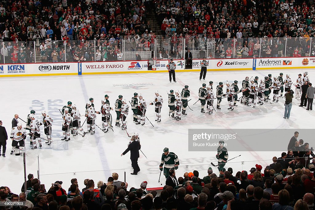 The Minnesota Wild and Chicago Blackhawks shake hands following Game Six of the Second Round of the 2014 Stanley Cup Playoffs on May 13, 2014 at the Xcel Energy Center in St. Paul, Minnesota.