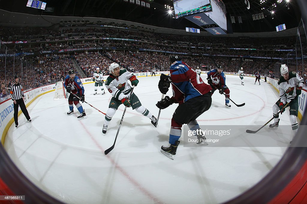 The Minnesota Wild and the Colorado Avalanche battle in Game Seven of the First Round of the 2014 NHL Stanley Cup Playoffs at Pepsi Center on April 30, 2014 in Denver, Colorado. The Wild defeated the Avalanche in overtime 5-4 to win the series.