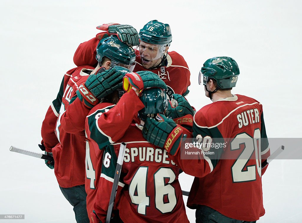 The Minnesota Wild celebrate a goal by <a gi-track='captionPersonalityLinkClicked' href=/galleries/search?phrase=Jared+Spurgeon&family=editorial&specificpeople=4594192 ng-click='$event.stopPropagation()'>Jared Spurgeon</a> #46 against the Calgary Flames during the third period of the game on March 3, 2014 at Xcel Energy Center in St Paul, Minnesota. The Wild defeated the Flames 3-2.