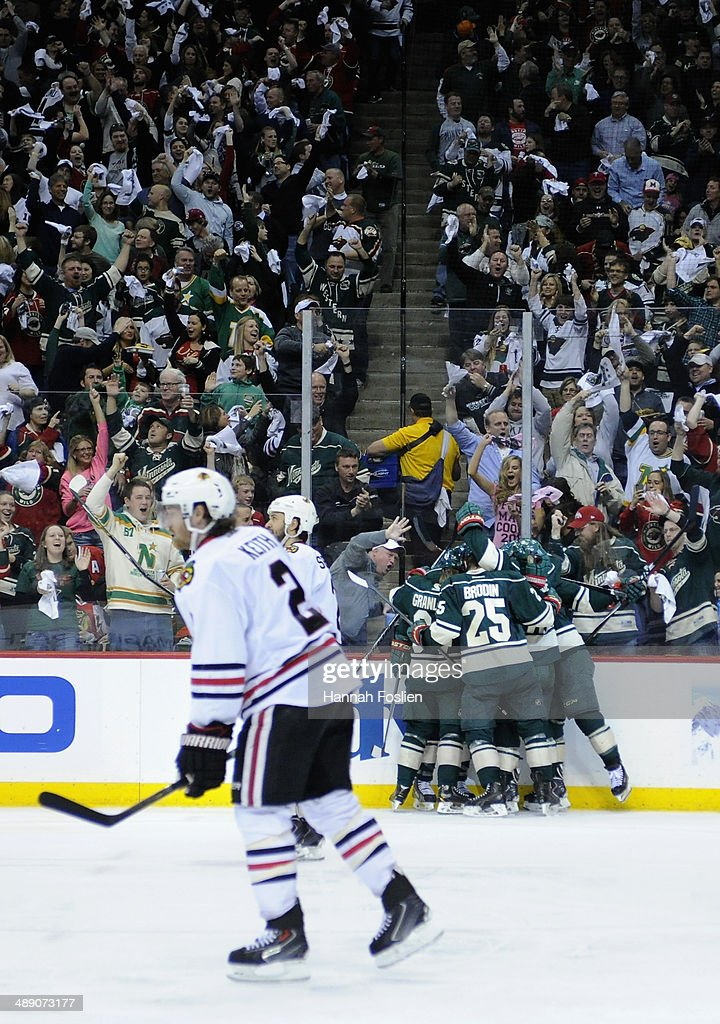 The Minnesota Wild celebrate a goal by Jason Pominville #29 as Duncan Keith #2 of the Chicago Blackhawks looks on during the second period in Game Four of the Second Round of the 2014 NHL Stanley Cup Playoffs on May 9, 2014 at Xcel Energy Center in St Paul, Minnesota.