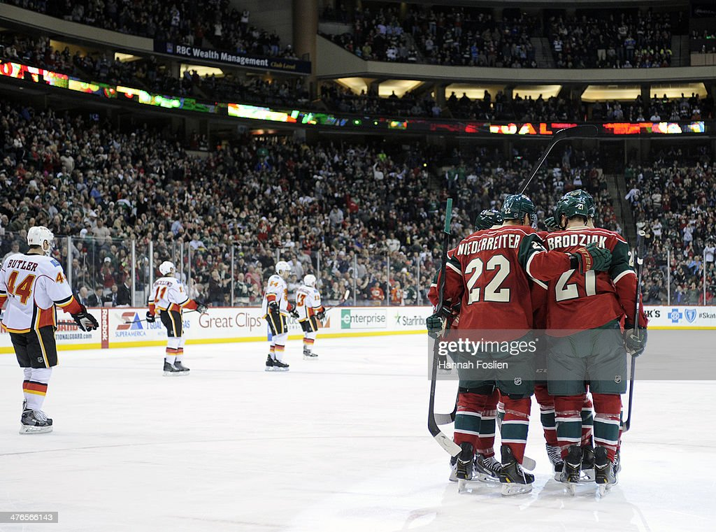 The Minnesota Wild celebrate a goal by Kyle Brodziak #21 during the second period of the game against the Calgary Flames on March 3, 2014 at Xcel Energy Center in St Paul, Minnesota.