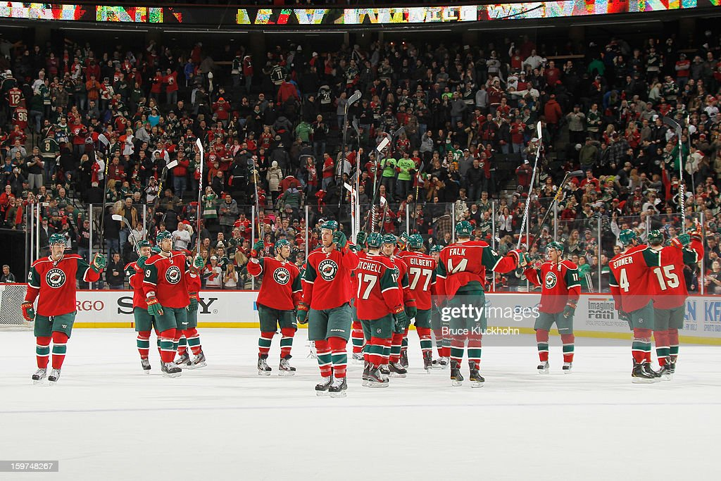 The Minnesota Wild celebrate after defeating the Colorado Avalanche on January 19, 2013 at the Xcel Energy Center in Saint Paul, Minnesota.