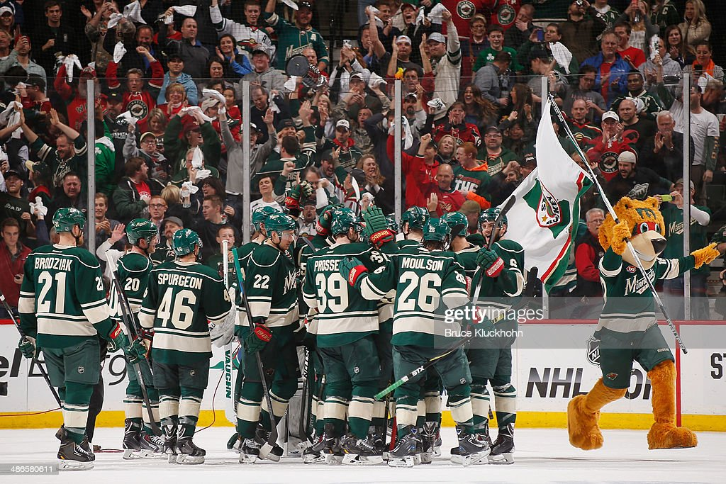 The Minnesota Wild celebrate after defeating the Colorado Avalanche in Game Four of the First Round of the 2014 Stanley Cup Playoffs on April 24, 2014 at the Xcel Energy Center in St. Paul, Minnesota.