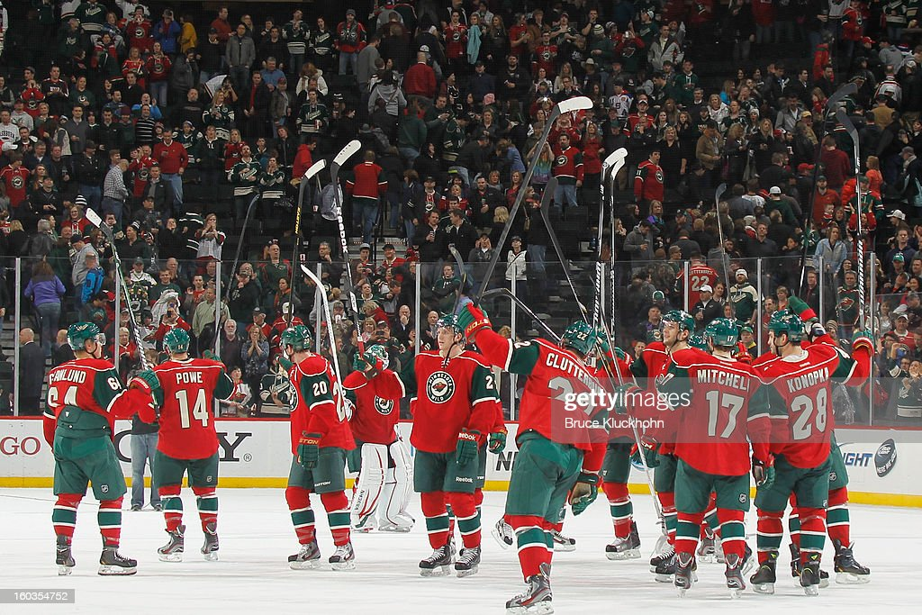 The Minnesota Wild celebrate after defeating the Columbus Blue Jackets on January 29, 2013 at the Xcel Energy Center in Saint Paul, Minnesota.