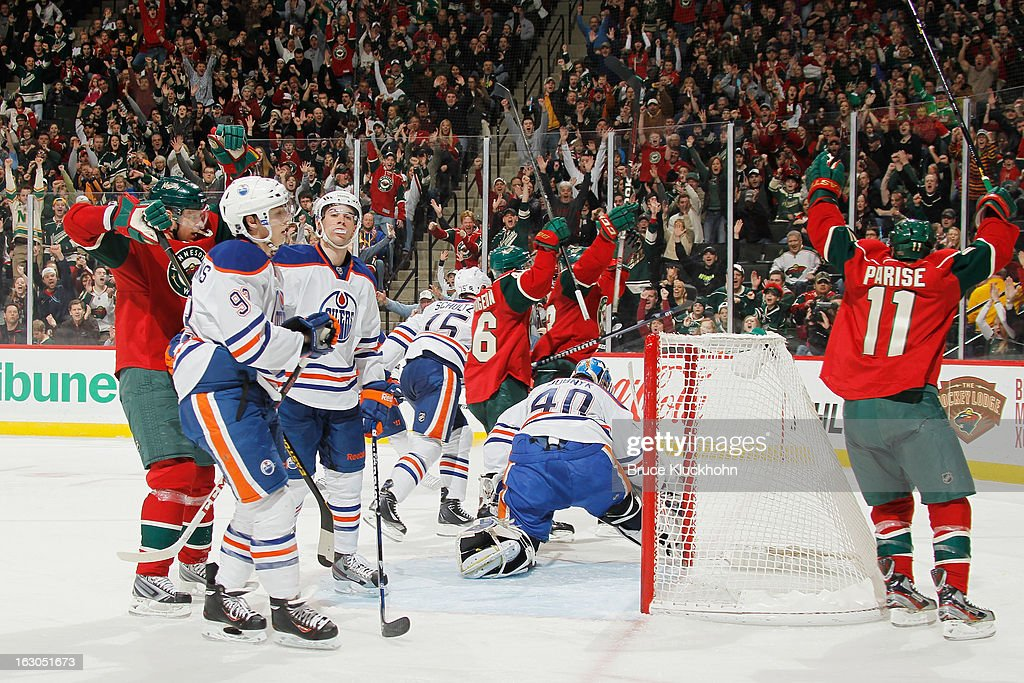 The Minnesota Wild celebrate after scoring a goal while the Edmonton Oilers show their disappointment during the game on March 3, 2013 at the Xcel Energy Center in Saint Paul, Minnesota.