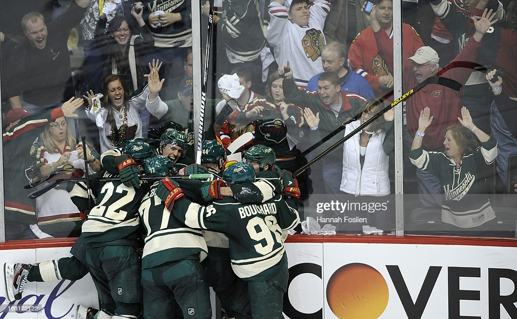 The Minnesota Wild celebrate an overtime win against the Chicago Blackhawks of Game Three of the Western Conference Quarterfinals during the 2013 NHL Stanley Cup Playoffs at Xcel Energy Center on May 5, 2013 in St Paul, Minnesota. The Wild defeated the Blackhawks 3-2 in overtime.