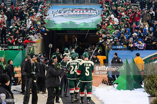 The Minnesota Wild celebrate as they return to the locker room after defeating the Chicago Blackhawks 6 to 1 during the 2016 Coors Light Stadium...