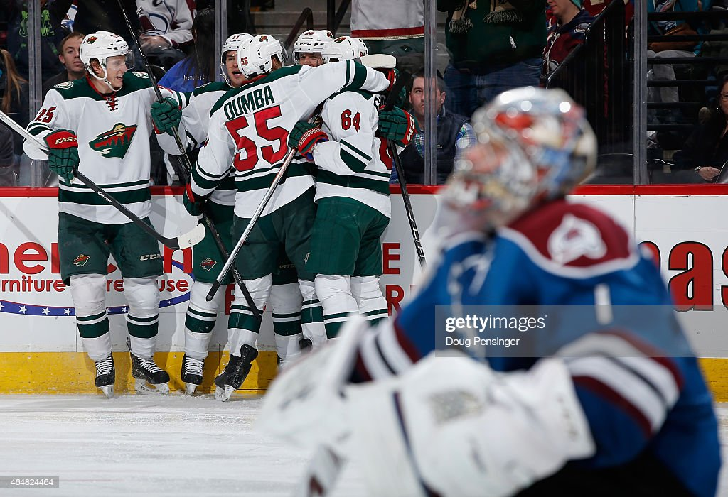 The Minnesota Wild celebrates a goal by <a gi-track='captionPersonalityLinkClicked' href=/galleries/search?phrase=Jason+Pominville&family=editorial&specificpeople=570525 ng-click='$event.stopPropagation()'>Jason Pominville</a> #29 of the Minnesota Wild against goalie <a gi-track='captionPersonalityLinkClicked' href=/galleries/search?phrase=Semyon+Varlamov&family=editorial&specificpeople=6264893 ng-click='$event.stopPropagation()'>Semyon Varlamov</a> #1 of the Colorado Avalanche to take a 3-1 lead in the third period at Pepsi Center on February 28, 2015 in Denver, Colorado. The Wild defeated the Avalanche 3-1.