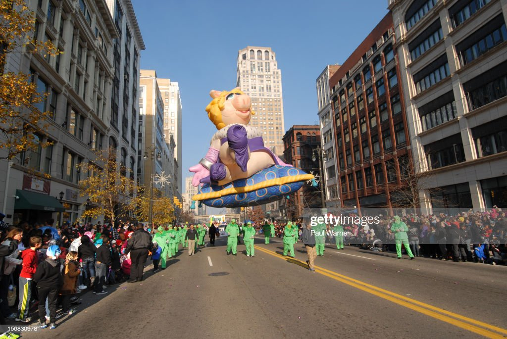 The Miss Piggy balloon is pulled down Woodward Ave by a group of Kermit the Frogs during America's Thanksgiving Day Parade at Woodward Avenue on November 22, 2012 in Detroit, Michigan.