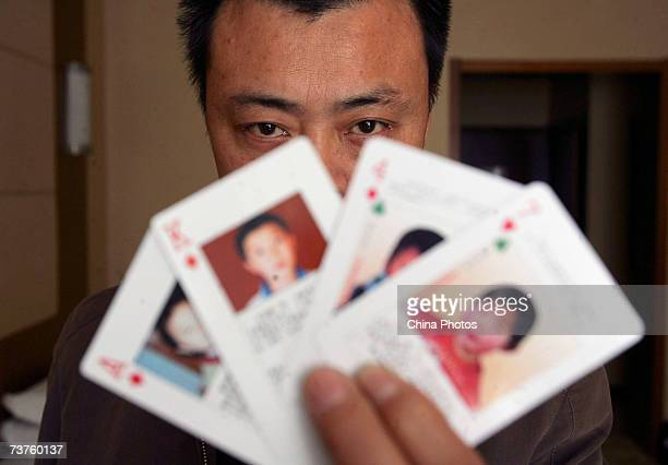 The 'missing children playing cards' are displayed by Shen Hao the founder of a missing person wetsite the wwwxrqscom on March 31 2007 in Beijing...