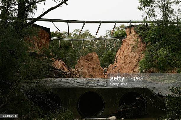 The missing section of the Old Pacific Highway where a family of five people were swept away in their car when the road collapsed June 10 2007 in...