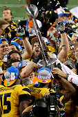The Missouri Tigers celebrate after the Tigers 4131 victory against the Oklahoma State Cowboys during the ATT Cotton Bowl on January 3 2014 in...