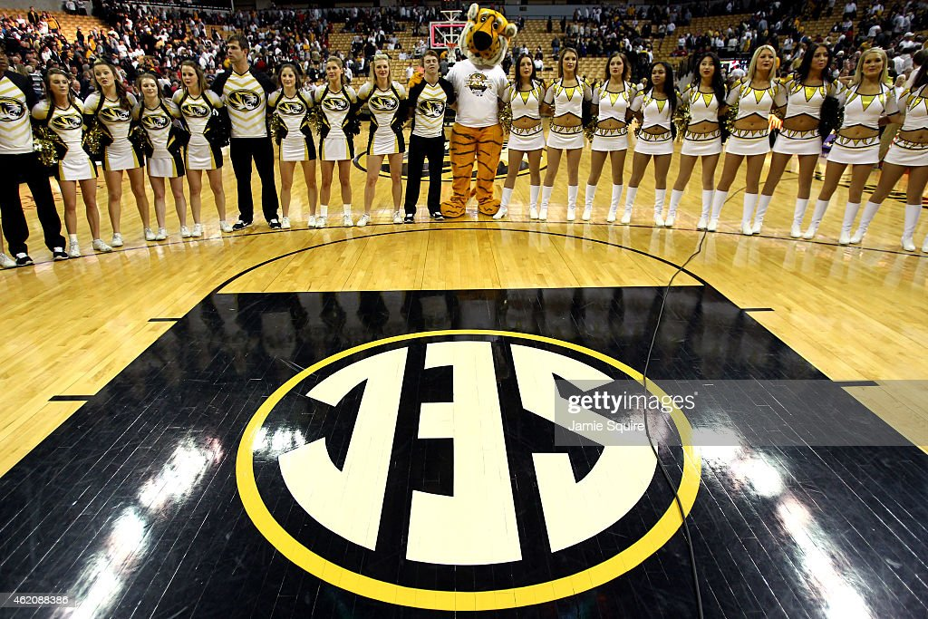 The Missouri Tigers mascot Truman joins arms with cheerleaders to sing the school anthem after the game between the Arkansas Razorbacks and the...
