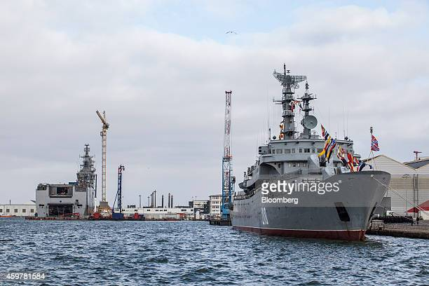 The Mistral class helicopter carrier Sevastopol left sits under construction as a Russian Navy vessel sits moored at the STX France SA shipyard a...