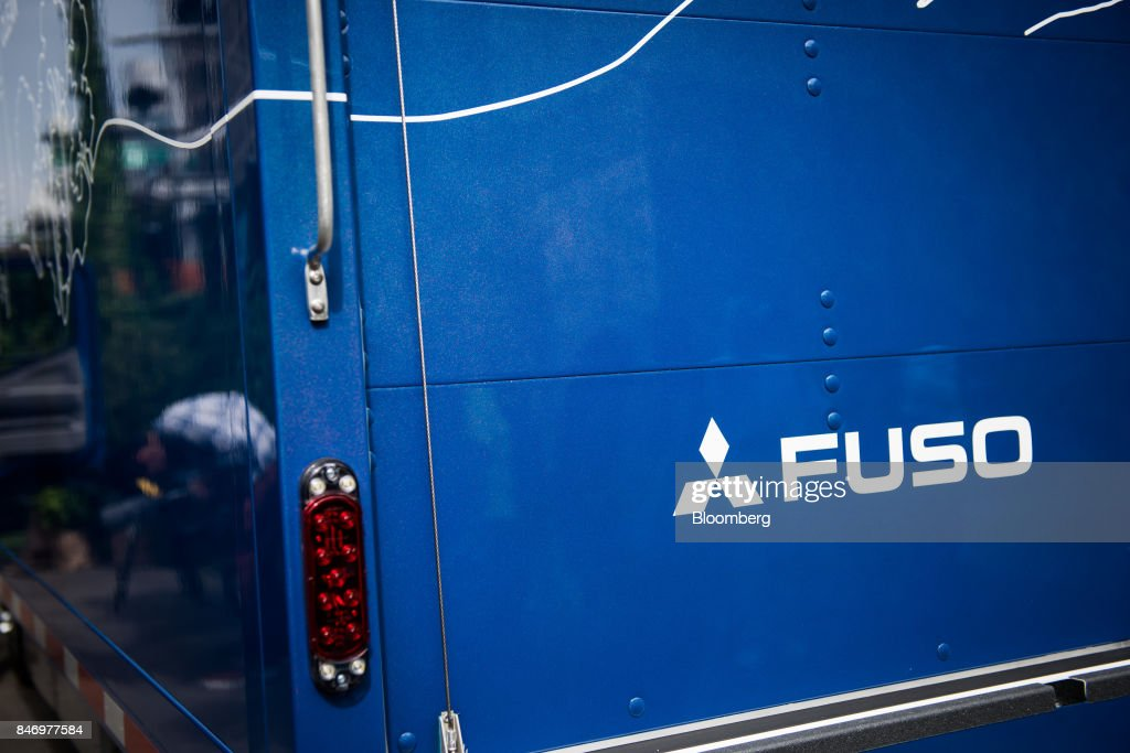The Mitsubishi Fuso Truck & Bus Corp. logo is seen on the side of the company's new eCanter truck during a launch event in New York, U.S., on Thursday, Sept. 14, 2017. The Daimler AG unit unveiled the new Fuso eCanter, an electric light-duty truck produced under its Mitsubishi Fuso brand. The latest version has a range of 60 to 80 miles (97 to 129 kilometers) between charges, depending on body, load and usage. Photographer: Mark Kauzlarich/Bloomberg via Getty Images