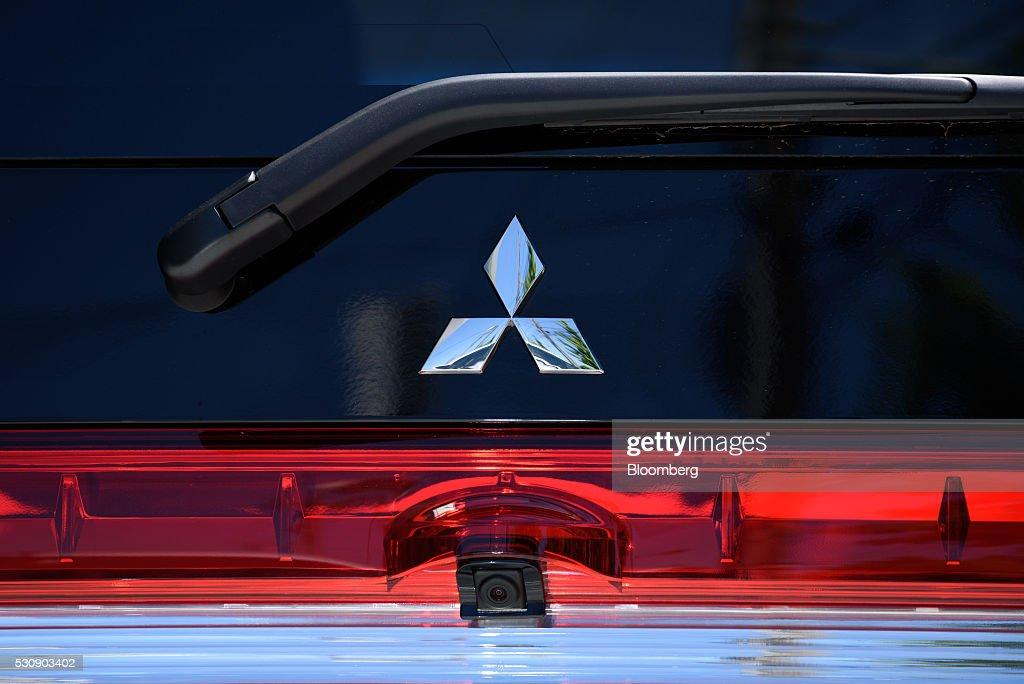 The Mitsubishi Motors Corp logo is displayed on a car sitting on display at one of the company's dealerships in Kawasaki City Kanagawa Prefecture...