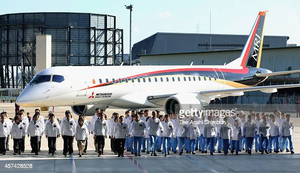 The Mitsubishi Regional Jet passenger aircraft developed by Mitsubishi Aircraft Corp is unveiled with its developping staffs during the rollout...