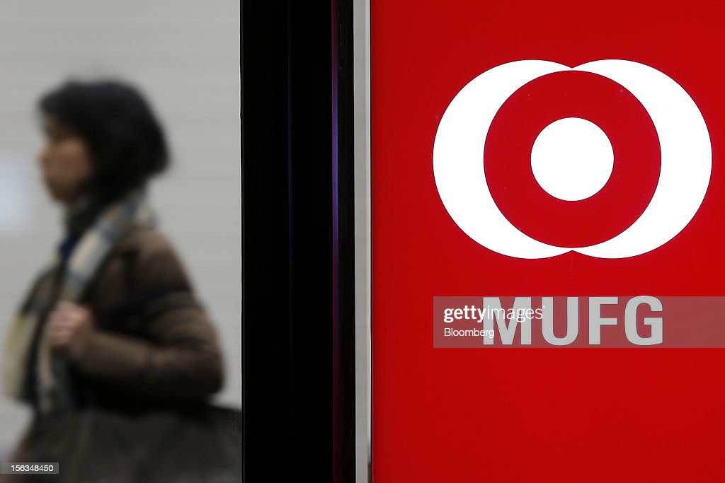 The Mitsubishi UFJ Financial Group Inc. (MUFG) logo is displayed at a branch of Bank of Tokyo Mitsubishi UFJ Ltd. in Tokyo, Japan, on Tuesday, Nov. 13, 2012. Mitsubishi UFJ Financial Group Inc. is scheduled to announce first-half earnings results on Nov. 14. Photographer: Kiyoshi Ota/Bloomberg via Getty Images