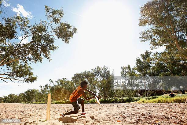 The Miwatj Dolphins from Arnhem Land in the Northern Territory play cricket in the dry Todd River during the 2415 Imparja Cup on February 11 2015 in...
