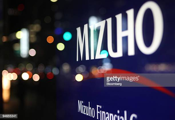 The Mizuho Financial Group Inc logo is displayed outside a Mizuho Bank Ltd branch in Tokyo Japan on Tuesday Nov 13 2007 Mizuho Financial Group Inc...