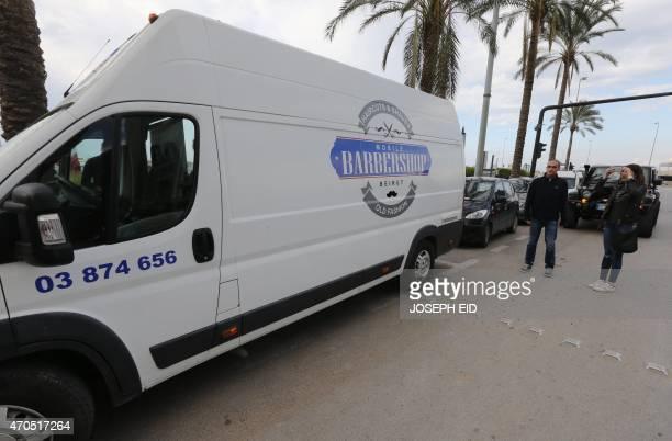 The mobile barber shop set up inside a van of Lebanese hairdresser Johnny Milan is seen in Beirut on March 19 2015 AFP PHOTO/JOSEPH EID