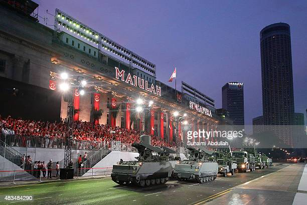 The mobile column display roll past in front of City Hall during the National Day Parade at Padang on August 9 2015 in Singapore Singapore is...
