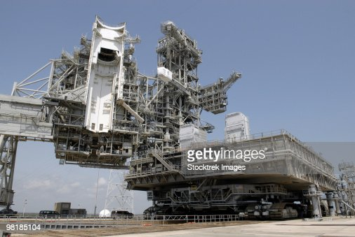 The mobile launcher platform is being moved via the crawler-transporter underneath.