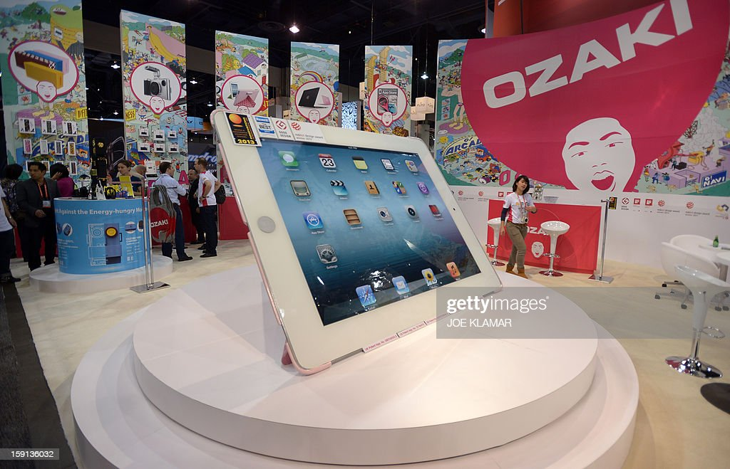 The model of giant iPad at Ozaki booth is seen at the 2013 International CES at the Las Vegas Convention Center on January 8, 2013 in Las Vegas, Nevada. CES, the world's largest annual consumer technology trade show, runs from January 8-11 and is expected to feature 3,100 exhibitors showing off their latest products and services to about 150,000 attendees.AFP PHOTO / JOE KLAMAR