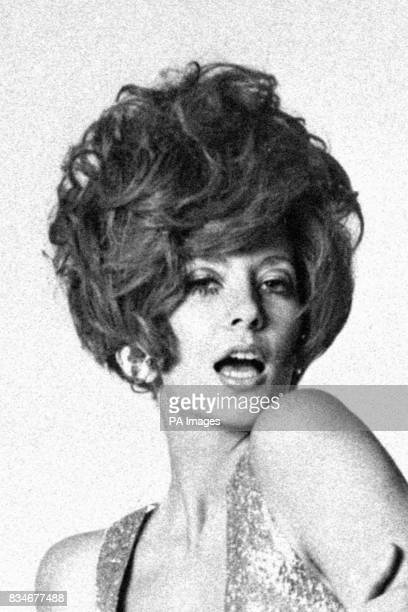 The model sports a bouffant hairstyle typical of the sixties