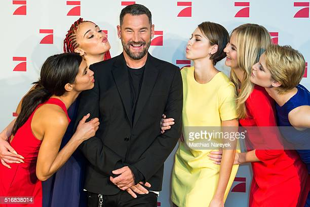 The models Luana Kim Laura Laura B Lara and designer Michael Michalsky pose during a photo call for the tv show 'Germany's Next Topmodel' on March 21...