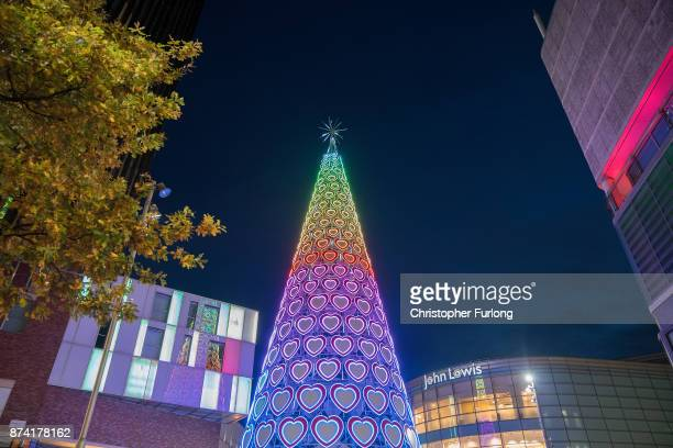 The modern Christmas tree of the Liverpool One retail park illuminates the sky as businesses in Liverpool switch on their Christmas lights and window...