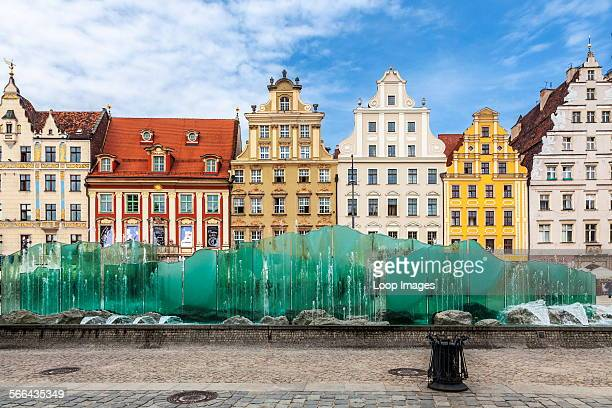 The modern fountain against a backdrop of medieval and Baroque houses in Wroclaw's old town Market Square or Rynek