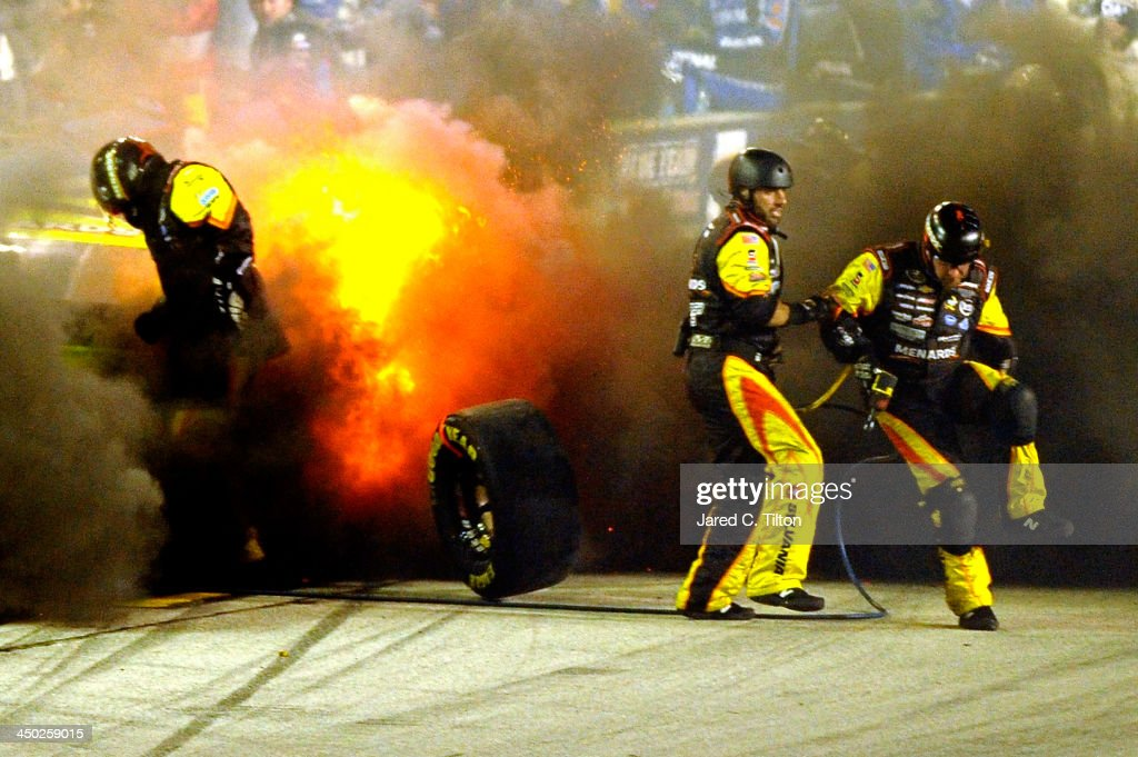 The MOEN/Menards Chevrolet driven by Paul Menard explodes during the NASCAR Sprint Cup Series Ford EcoBoost 400 at HomesteadMiami Speedway on...