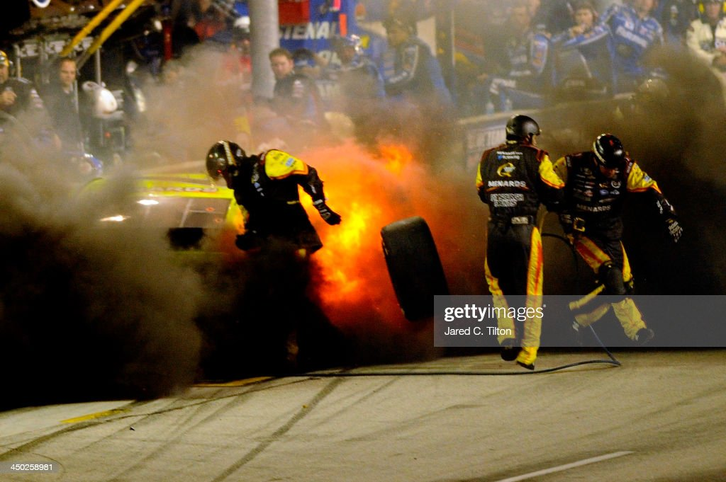 The MOEN/Menards Chevrolet explodes during the NASCAR Sprint Cup Series Ford EcoBoost 400 at HomesteadMiami Speedway on November 17 2013 in Homestead...