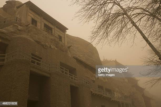 The Mogao Grottoes experience the first regional dust weather of this spring on March 31 2015 in Jiuquan Gansu province of China Sand storm hits...