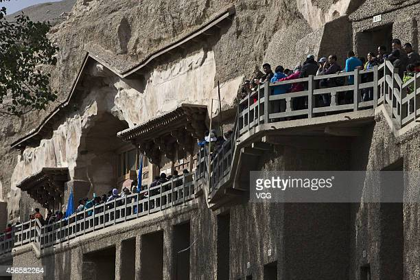 The Mogao Grottoes is crammed with tourists on the third day of the National Day holiday on Ocober 3 2014 in Dunhuang China China's goldenweek...