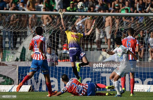 The Moghreb Athletic of Tetouan's goalkeeper el Youssefi Mouhamed tries to block the ball during the match Raja Club Atletic VS Moghreb Athletic of...
