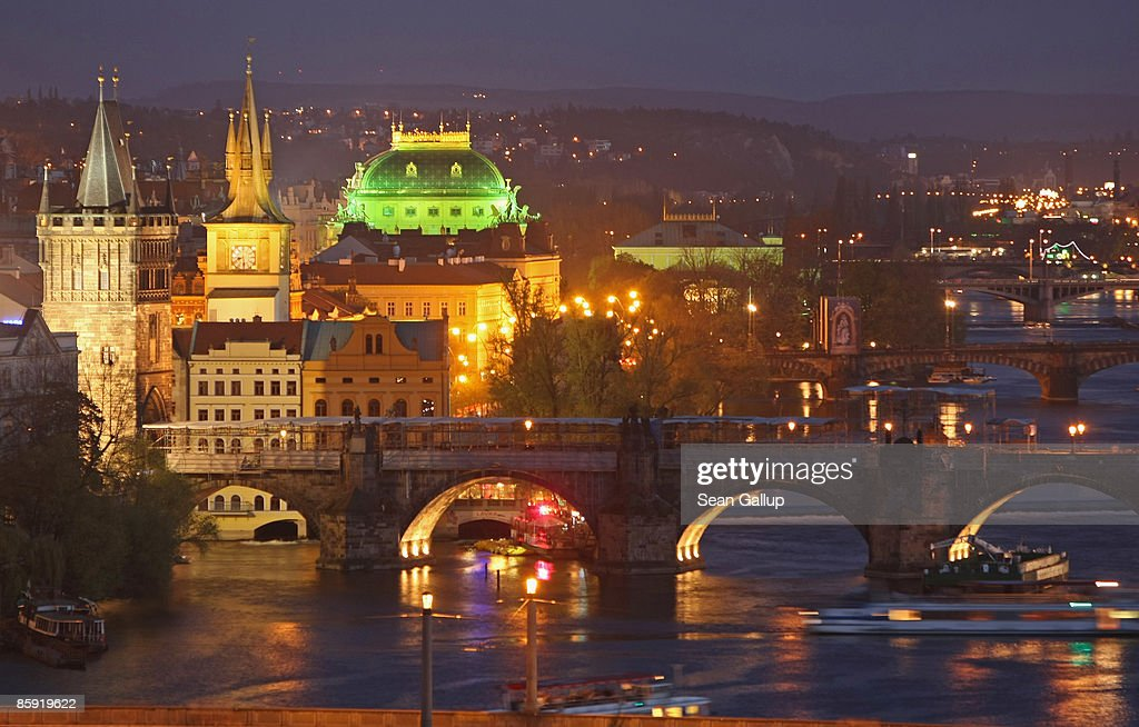 The Moldau River flows under the Charles Bridge and past buildings in Old Town on April 12 2009 in Prague Czech Republic Prague is among Europe's...