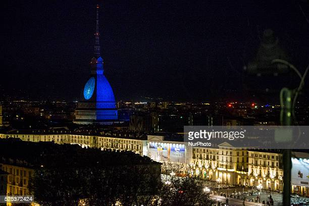 The Mole Antonelliana the monument symbol of Turin pictured with quotLight It Up Bluequot logo for the World Autism Awareness Day