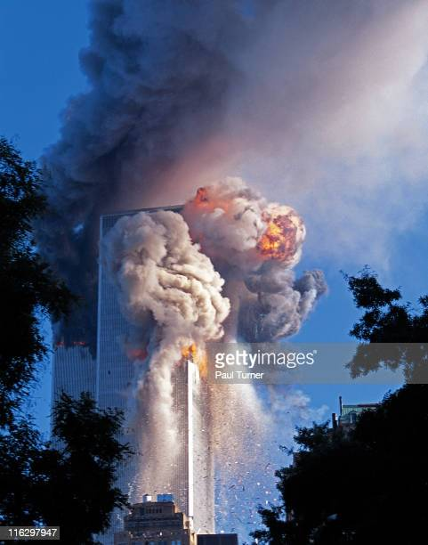 As seen from Battery Park in South Manhattan a fireball explodes in a cloud of smoke and debris from the South Tower of the World Trade Center as it...