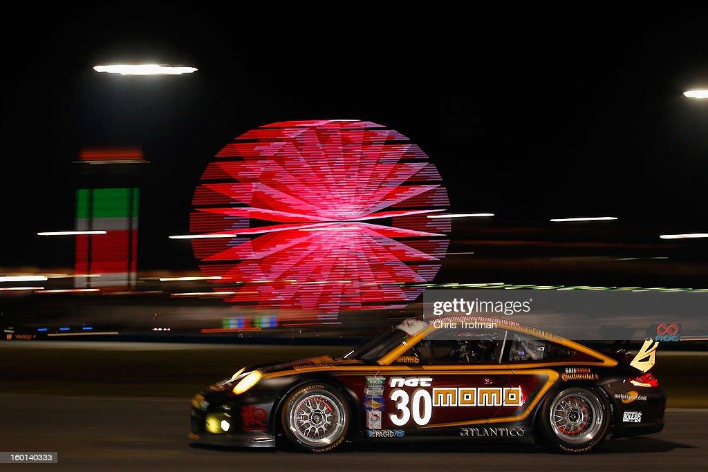 The #30 MOMO/NGT Motorsport Porsche GT3 driven by Henrique Cisneros, Sean Edwards, Kuba Giermaziak and Patrick Pilets drives during the Rolex 24 at Daytona International Speedway on January 26, 2013 in Daytona Beach, Florida.