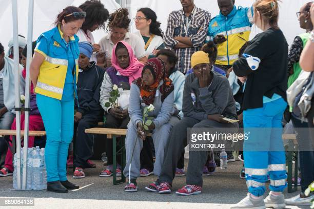 The moms of the dead children in the sea wait for their last greetings to their children during the phase of landing migrants from Phoenix MOAS ship...