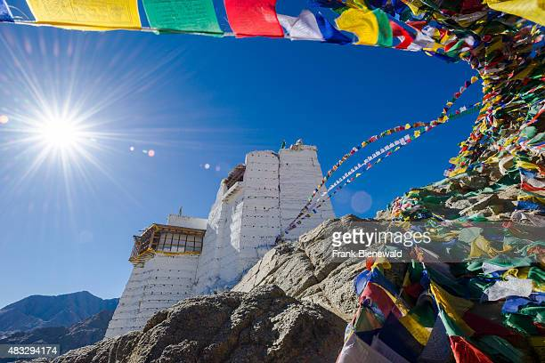 The monastery Namgyal Tsemo Gompa and Tsemo Fort surrounded by tibetean prayer flags are located high above the old part of town on a mountain ridge